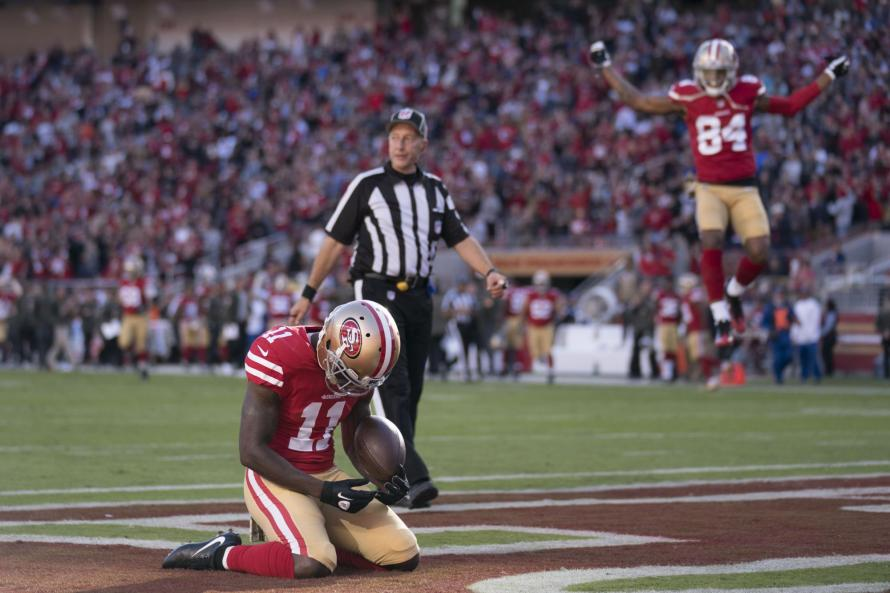 Marquise Goodwin reacts to his touchdown