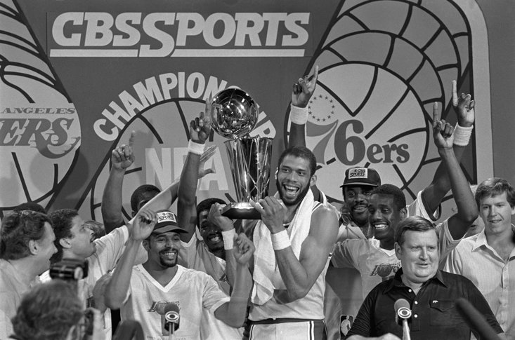 Abdul-Jabbar with the NBA Championship in 1982