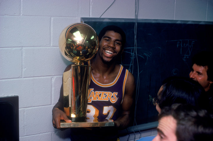 Johnson with his 1980 NBA Championship trophy