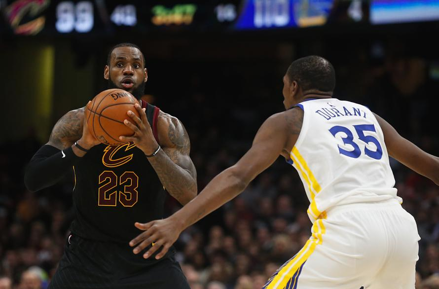 Cleveland Cavaliers forward LeBron James looks to pass against Golden State Warriors forward Kevin Durant