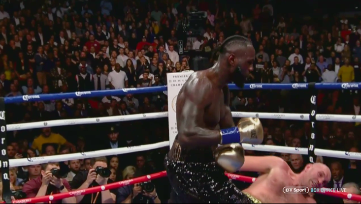 Wilder puts Fury on his back with a stinging left hook