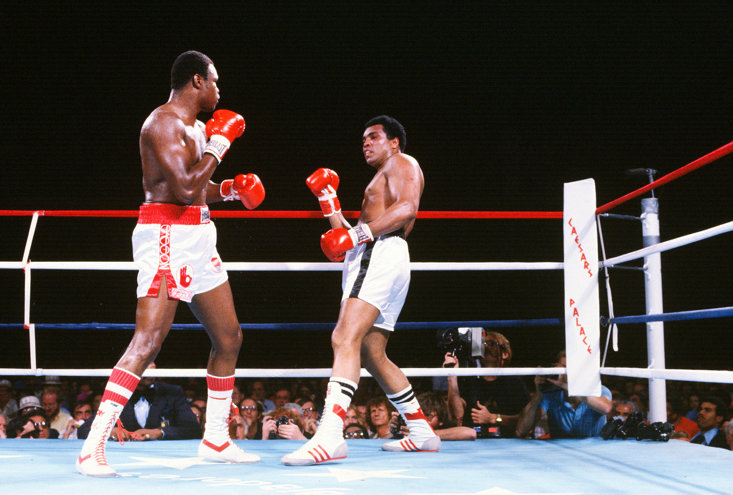 Larry Holmes squares up to his friend and former sparring partner, Muhammad Ali