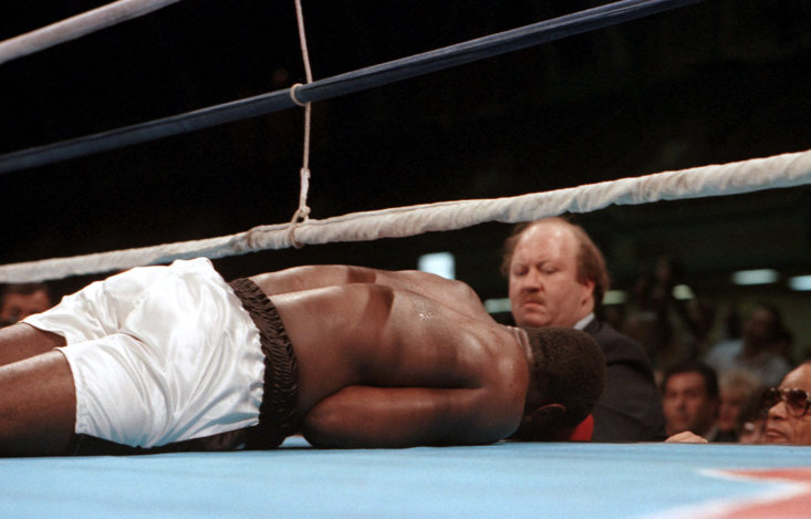 Qawi hits the canvas in round four in the 1987 rematch with Holyfield (Getty Images)