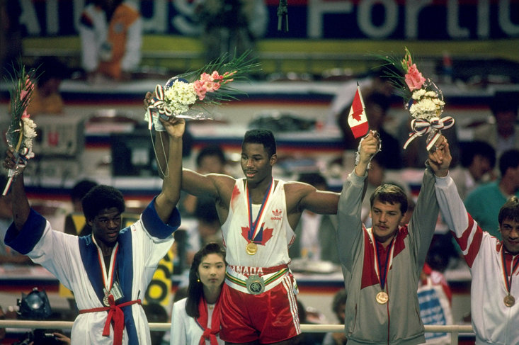 LEWIS WON GOLD IN 1988 UNDER THE CANADIAN FLAG