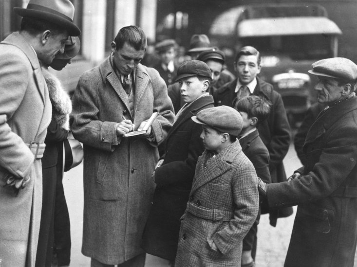 Berg signs autographs for young fans on his return from the USA