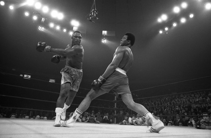 Muhammad Ali evades his great rival, Joe Frazier (Getty Images)