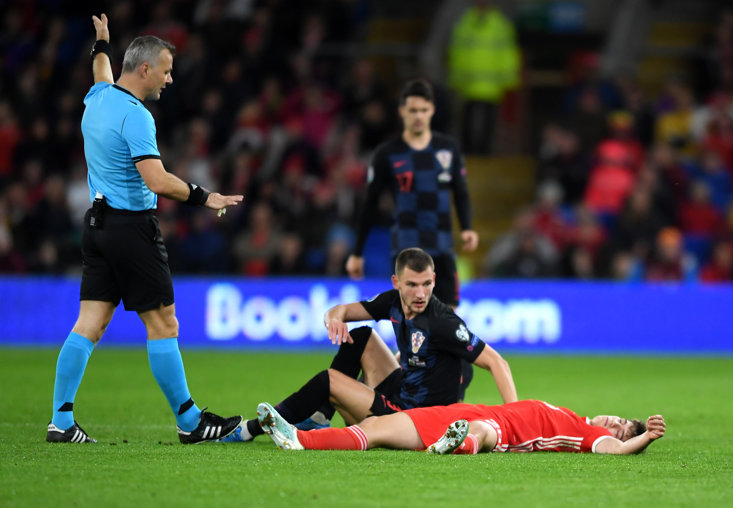 Wales footballer Daniel James lies prone after suffering a head injury in a Euro 2020 qualifier