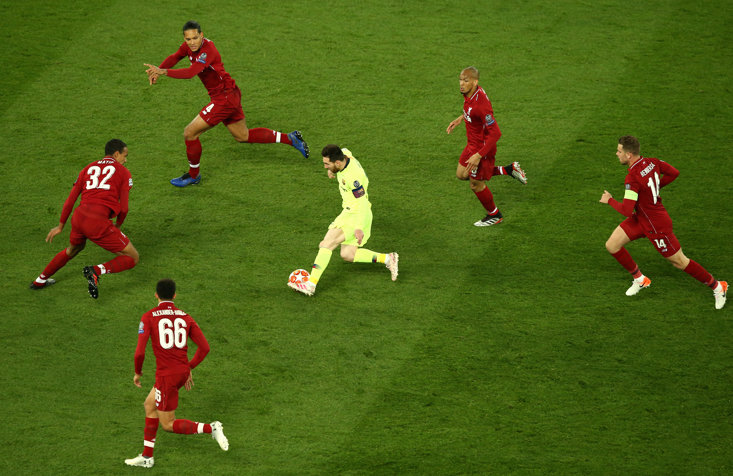 Messi swamped by Liverpool players in the Champions League