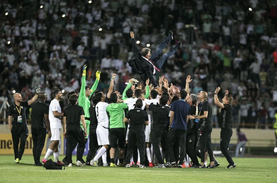 Carlos Queiroz is thrown into the air by his players after Iran beat Uzbekistan 2-0 in Tehran, to qualify for the 2018 World Cup