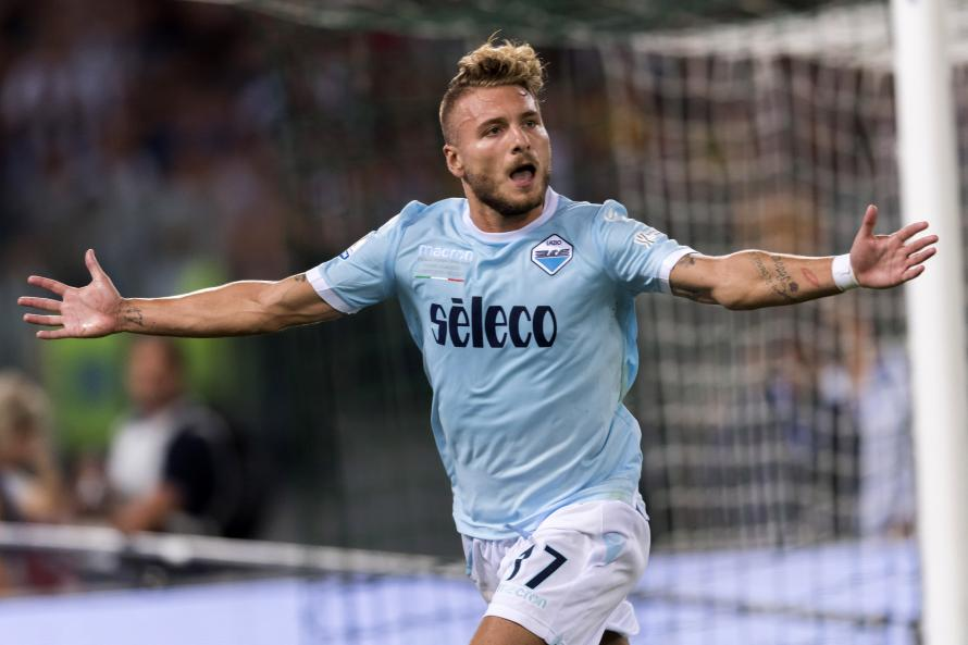 Napoli win but exit Europa League, Lazio's Immobile hits hat-trick