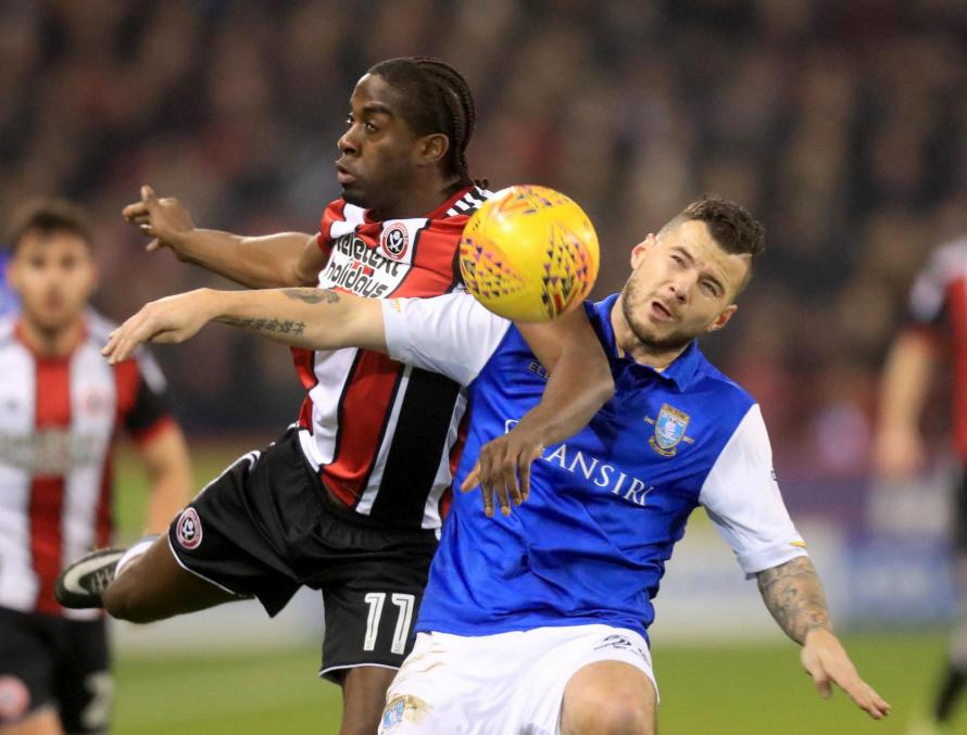 Sheffield Wednesday's Daniel Pudil (right) and Sheffield United's Clayton Donaldson battle for the ball during the Sky Bet Championship match at Bramall Lane.