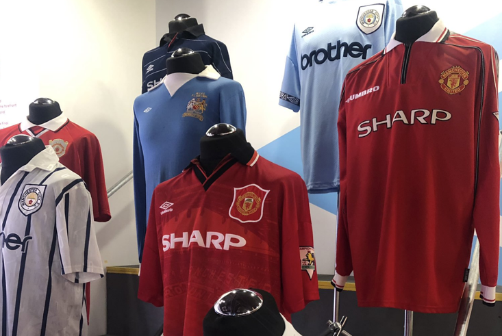 Some of the Manchester City and Manchester United shirts on display