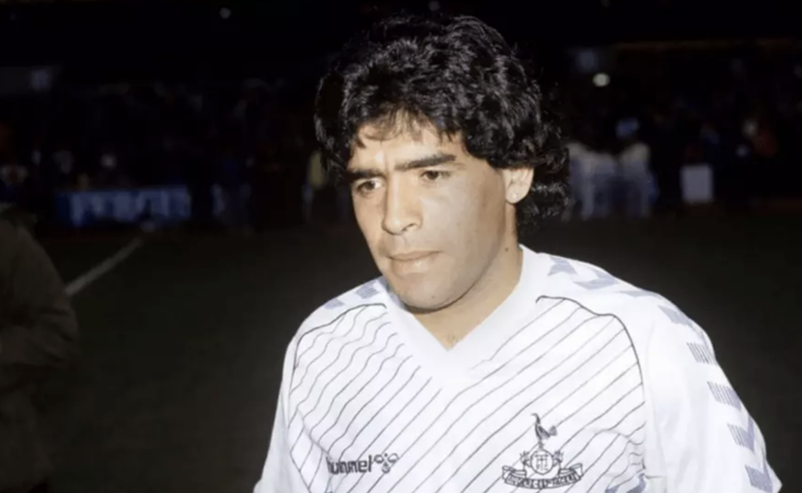 Diego Maradona wearing a Spurs shirt back in 1986