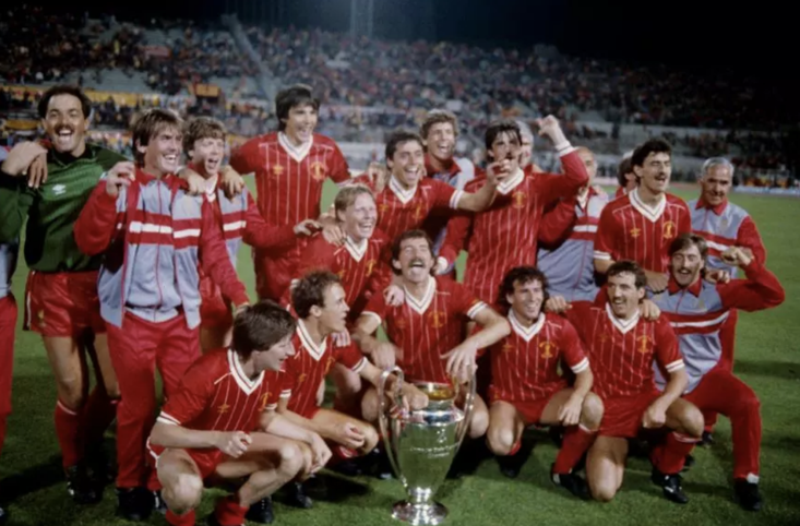 Liverpool players and coaching staff celebrate with the European Cup: (back row, left to right) Bruce Grobbelaar, Kenny Dalglish, Steve Nicol, Alan Hansen, Michael Robinson, Gary Gillespie, Mark Lawrenson, Ronnie Moran, Ian Rush, Tom Saunders; (front row, left to right) Ronnie Whelan, Phil Neal, Sammy Lee, Graeme Souness, Craig Johnston, Alan Kennedy and David Hodgson