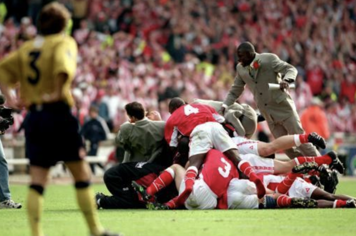 Sunderland's Michael Gray (left), who missed the decisive penalty, can only watch as the Charlton Athletic players celebrate