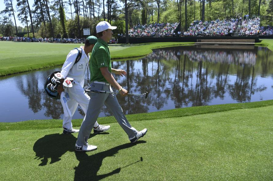 Reed storms into Masters lead