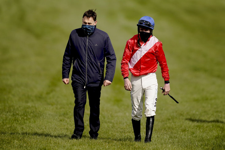 JOCKEY JACK KENNEDY TRUDGES BACK WITH TRAINER HENRY DE BROMHEAD AFTER ENVOI ALLEN'S FALL