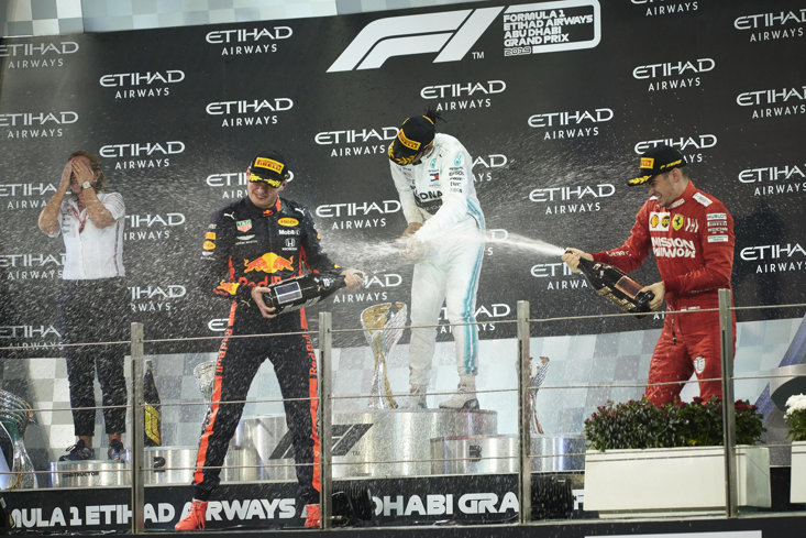 Verstappen (Left) and Hamilton (Centre) celebrate a podium finish at the Abu Dhabi GP