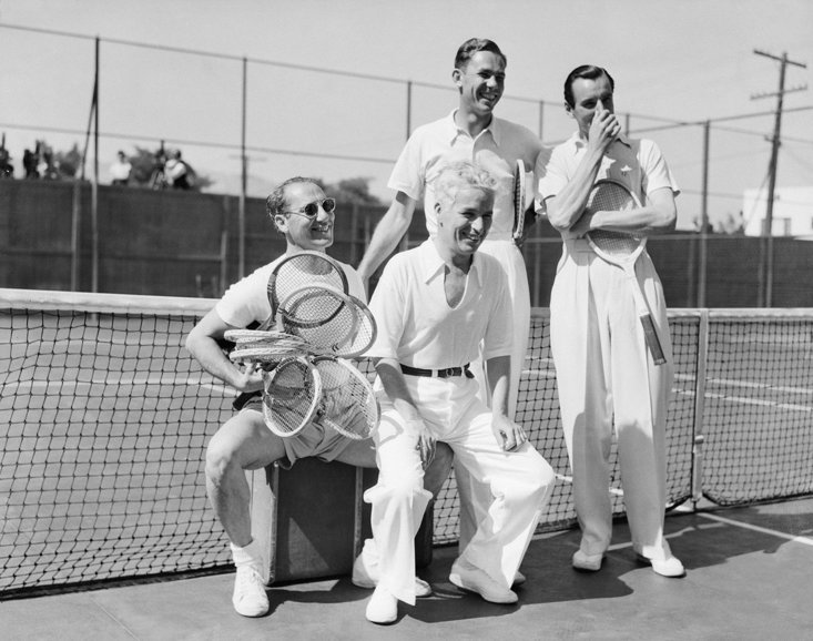 Fred Perry alongside Charlie Chaplin and Groucho Marx (Getty Images)